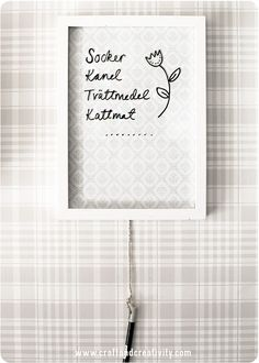DIY erasable board by Craft & Creativity - frame a piece of patterned or coloured paper and write with whiteboard pen.