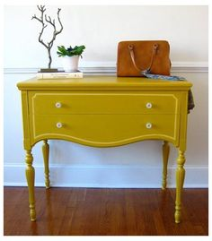 funky furniture.  Love the mustard color of this little table