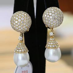 @dupuisauctions.Impressive pair of pearl and diamond ear pendants by Van Cleef & Arpels.