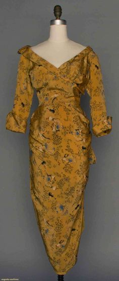 ~Late 1940s Ceil Chapman curry-colored silk dress~      w/pencil print of dancing couples amongst scattered flowers, surplice bodice, narrow shawl collar, 3/4 length sleeves w/deep cuff, sarong-style wrap skirt in narrow tulip shape, with label, Via Augusta Auctions.