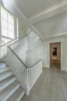 gray flooring Custom Designed staircase with stained oak hand railing. Floors throughout Exquisite Surfaces NYC - Blonde Manoir Gray Color Flooring For Stairs, Oak Stairs, Wood Staircase, Staircase Remodel, House Stairs, Grey Flooring, Staircase Design, Stair Railing, Hand Railing