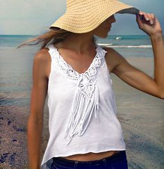 Trash To Couture -   http://www.trashtocouture.com/2013/06/diy-macrame-fringe-top.html?utm_source=feedburner_medium=email_campaign=Feed%3A+TrashToCouture+%28Trash+To+Couture%29     Supplies: Tshirt or jersey string  Shirt for applique  clip board for macramé    Video on how to make it  https://www.youtube.com/watch?v=BjP5Q4vI-sA