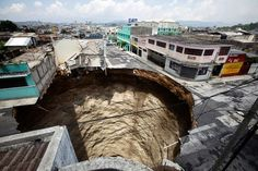 Buildings perch precariously over a sinkhole that collapsed in 2010 in downtown Guatemala City.