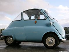 A 1958 BMW Isetta, probably the cutest car of all time. (the door is on the front)