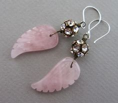 On Loving Wings Handmade Boho rose quartz earrings. Special earrings to wear on a day when you need a little reminder of what is important, or when you just want to show your fun side. Rose quartz carved wings and balls of rhinestone crystals from the Czech republic, sterling silver ear wires.
