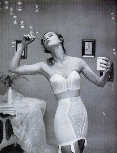 Don't you love these vintage ads? Didn't everyone get dressed in a bra and girdle and blow bubbles? And why is it that the models are almost never wearing stockings?