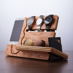 "Watch and Eye Dock $29.99 Product Details — Integrated Slot That Can Keep 3 To 4 Watches  — Carved Pocket For Eyeglasses, Sunglasses  — Slot To The Side Can Securely Store A Wallet Or Check Book  — Storage In The Rear For Keys Or Change  — Curved Wire to Remove Phone Without Disturbing Dock  Colors Natural Wood MaterialsRed Oak Plywood Measurements10""L x 4""W x 7""H Origin United States"