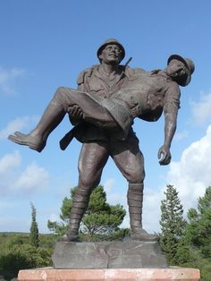 "Gallipoli battlefield cemetery  statue of an Ottoman soldier carrying a wounded ANZAC soldier      ""As the cries of the wounded continued and the hot sun rose, the Anzacs were moved to pity. They had never seen such bravery before. A truce was arranged and Anzacs and Turks together helped to bury the dead.""    --A.K. Macdougall, Australia in History: Gallipoli and the Middle East, 1915-18, 2004"