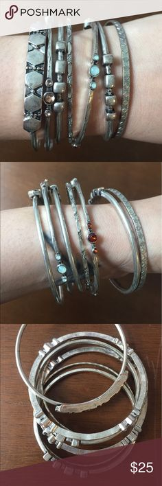 "FP Distressed Boho Bangle Set with Stones Super cute stacking bangle set from Free People. Awesome designs with different colored stones and gems throughout. There are seven bracelets total and can we worn together or separate! Set shows slight wear (see images) but came with some ""tarnishing"" already which adds to the distressed boho look. I believe these will probably patina more with wear but I think that looks really cool! Set was originally $48 and no longer available. Free People…"