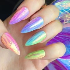 These nails be HELLA! Ombré rainbow covered in an illusion shimmer with slices of holo! Damn, need I say more? Designed and hand painted by myself....