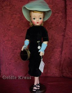 "Cissy Doll in Original Outfit: ""Matinee"" Cissy from 1958, dressed in a Black Velvet Sheath, Blue Hat & Gloves with Chatelaine Watch. This doll was bought from the son of the original owner who was a union toy rep in NYC during the 1950's for M.A., Ideal, & A.C. dolls."
