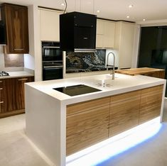 A fantastic island incorporating all the kitchen elements. The Corian working well with the wood base to give a sleek modern and a rustic feel all at the same time Corian, Rustic Feel, Design Kitchen, Kitchen Island, Base, London, Interior Design, Architecture, Wood