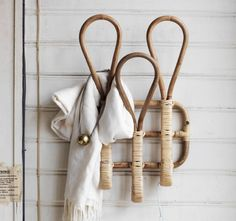 $8.99 hand towel holder for the kids' bathroom Close-up of a rattan rack with three hooks.