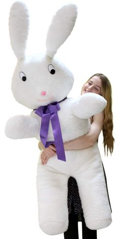 American Made Giant Stuffed Bunny 60 Inch Soft Big Plush 5 Foot Rabbit Made in USA. *NOTE: PHOTOS TAKEN OUTDOORS FOR SIZE COMPARISON * USED FOR DEMONSTRATION PURPOSES ONLY. *NOTE: YOU WILL RECEIVE BRAND NEW MERCHANDISE (that has NEVER been outdoors) - BRAND NEW. Very large stuffed bunny rabbit- A WHOPPING FIVE (5) FEET TALL - Big attention-getter. Soft white plush fur and soft polyester stuffing with a hint of supple firmness to ensure stability. Purple color satin neck-ribbon bow adds a...