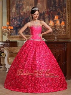 Wonderful Coral Red Quinceanera Dress Strapless Fabric With Rolling Flowers Appliques Ball Gown  http://www.fashionos.com  This ball gown is everything that you have ever dreamed a quinceanera dress could be! Strapless dresses are one of the sexier styles on the market today. They show just enough skin to be classy without being too revealing. It features a pretty strapless bodice embellished with beading and rhinestones.