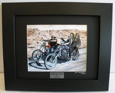 """Easy Rider theme, Limited Edition Custom Framed Motorcycle Art Print, Indian & Harley Choppers, Hand Signed & #'d w/certificate Biker Wall Art - Original Painting by John Guillemette. This artwork is produced from John Guillemette's original oil painting titled: """"Captain America & Billy"""". The Painting has been featured in both V-Twin and Easyriders magazines in articles about the artist. Hard wood black framing and mounted in a Raven black mat. The size is 11"""" x 14"""", (inside glass..."""