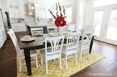 House of Turquoise: Four Chairs Furniture Hiya Papaya Photography -- dark table with white chairs.I love this kitchen. Kitchen Dinning, Dining Room, Open Kitchen, Dark Table, Mismatched Chairs, House Of Turquoise, Yellow Rug, Room Rugs, Home Kitchens