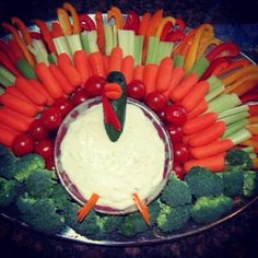 Fun ideas for a vegetable tray of a Thanksgiving food table.