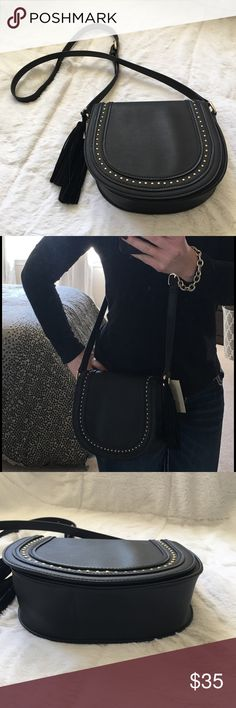 Rebecca Minkoff inspired cross body black bag 👜 Brand new with tags! Black cross body bag made out of man made materials! Gold hardware, tassels, and gold detailing make this bag great for day to evening wear! Has snap closure with one inside zipper compartment. Bag measures 8 in high x almost 9 in wide x 3 in deep Bags Crossbody Bags