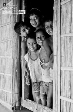"""Happy Faces, by Tamal Debnath - Taken At Falimari, a village situated between two rivers.Boats are the only medium of transportation to reach there.There are no Secondary school for these little folks.Devoid of proper education, nutritious food, and roof, they are still the """"Happy Faces""""."""