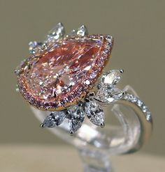 Pear shaped pink Diamond with a sparkling halo and a floral design feature. Pink Jewelry, Gems Jewelry, Jewelery, Unique Jewelry, Jewelry Accessories, Pink Diamond Ring, Pink Diamonds, Pink Diamond Engagement Ring, Solitaire Engagement