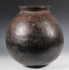"AFRICAN POTTERY - Makonde People, Tanzania and Northern Mozambique, Medium Pot in spherical form with flared rim, incised with rings and vertical lines, in raw umber clay, glazed. 13"" tall, 12"" diam. Rim chips. Proceeds to benefit The Museum of African Culture in Portland, Maine"