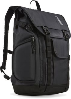 """Thule Subterra Daypack-Dark Shadow. Fits 15"""" MacBook Pro (14.1"""" PC) + iPad (10.1"""" tablet). SafeEdge corner protection for laptop plus padded tablet sleeve with quick secondary access to hardware through side zipper. Molded SafeZone for smartphone, sunglasses and other important items. Duffel style front zipper opens the bag wide and creates easy access & visibility to the entire main compartment. Interior mesh pocket keeps smaller items in a visible and accessible location and is zippered..."""