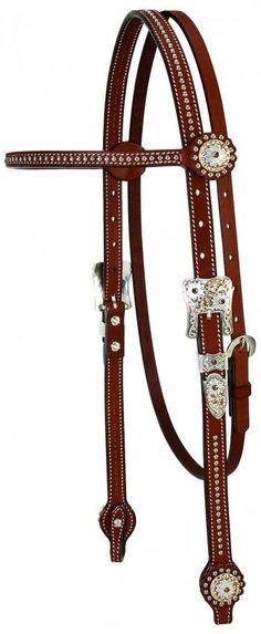 """A touch of sparkle gives these headstalls a high end look that's perfect for the show ring. These 3/4"""" headstalls have a slim, stylish 1/2"""" browband or flat sliding ear that perfectly accents any horse's head. Special details like etched nickel brall spots, smoothed and darkened leather edges and Swarobski crrystal accents offer added appeal. $152.98 from Working Horse Tack."""