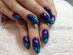 Gel nails, black nails, pointed stilletto almond nails, foil nail art, purple