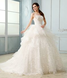 Wedding dresses can make gorgeous quince dresses --and no one will know the difference! Elegant Ball Gown Court Train Organza Lace Wedding Dress