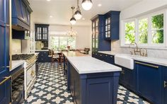 blue-kitchen-cabinets-gold-pulls-blue-moroccan-tile-floor-blue-range-hood
