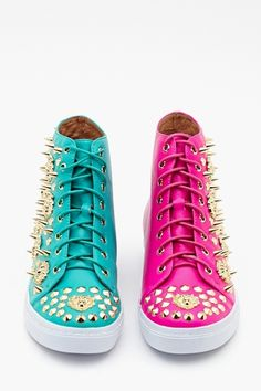 Adams Spike Sneaker - Two Tone  $188.00  Color: FUSCHIA/TEAL  Mix it up in these hot two-tone leather high-tops featuring gold spikes and lion studded detailing. One sneaker is teal, the other is fuschia! Lace-up front, white rubber sole. Genuine leather lining, cushioned insole. Looks rad with a tight dress and moto jacket! By Jeffrey Campbell.