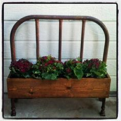 planter made out of an old bed headboard