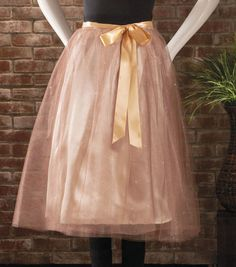 Pair this glitter tulle wrap skirt with a plain top for a fun party outfit!