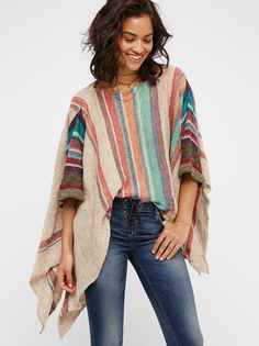 Fressia Stripe Pullover | Stripped knit pullover top with an asymmetrical hem, dolman sleeves and side vents.