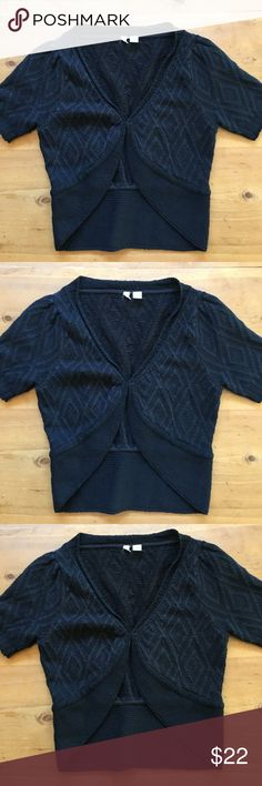 Anthropologie Moth Black Sweater Great condition soft shorts sleeve clasp closure 19 inches long 16 inch bust sleeves 9 1/2 inches long wonderful with jeans skirts for over a dress to stay warm on a cold night size medium 55% linen 15% rayon 15% nylon 15% cotton super cute💕 Anthropologie Sweaters