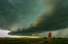 The photo was taken in July 31, 2012. I was just getting into photographing storms, and headed out on this stormy evening with a neighbour who also loved to photograph storms. This stormy sky was taken 2 km outside of my hometown Olds AB . The photo was taken just before 6 pm in the evening.