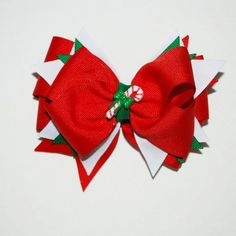 Candy Cane Holiday Hair Bow. $8.99, via Etsy. bytina design