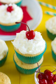 Sweet piña colada cupcakes filled with pineapple and topped with a light and fluffy pineapple coconut cream cheese frosting. There's a little bit of summer in each bite!