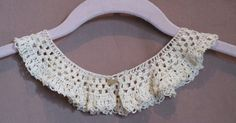 A crocheted collar I rescued from a thrift shop.  This is more of an ecru in color.