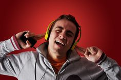 youn man listening to music with headphones