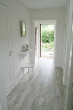Grey floor in the hallway - definitely gives a light feeling to the room. Want this color in the kitchen