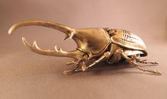 Sterling Silver Articulated Hercules Beetle Hercules Beetle. Sterling Silver. Length: 13 cm Width: 6 cm Moving parts: 24 By: Oleg Konstantinov  olegkonstantinovmetalwork.com