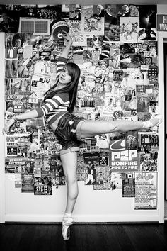 Young woman demonstrating ballet in front of a full pictured wall.