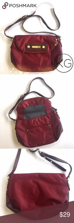 """Adrienne Vittadini Maroon Crossbody Travel Bag In great pre-owned condition! •12"""" wide x 8"""" tall x approx. 2"""" deep •44"""" adjustable strap, magnetic closure •Interior zipper pockets, 2 cell phone pockets, 1 front pocket, zippered flap pocket- see photos! •Retail $70 🚫no trades nor lowball offers🚫 Thank you for shopping in my closet! Adrienne Vittadini Bags Crossbody Bags"""