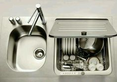 A kitchen with a dishwasher would be nice. Love how it hides under a lid.
