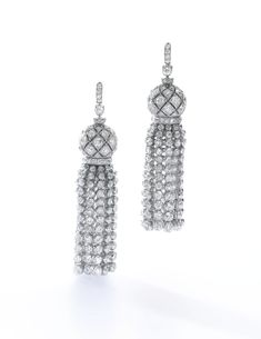 Pair of diamond pendants, Cartier, 1911 Each designed as a tassel, set with circular-, single-cut and rose diamonds, unsigned, French assay and maker's marks for Henri Picq, later brooch fittings set with circular-cut diamonds.