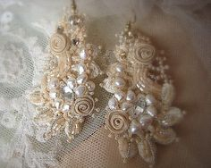 These beautiful earrings are made from ivory cotton needle - lace, hand embroidered with pearls and crystals.  Measurements : length - 7,5cm, w: 4,5