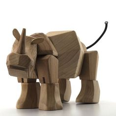 Simus the wooden rhinocerous, designed by David Weeks in the style of the great Danish designer Kay Bojesen