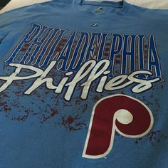 Awesome Philadelphia Phillies Tee-Shirt . Small A+ Perfect logo on this small Philadelphia Phillies MLB Tee-Shirt . A+ condition . PLAY BALL ⚾️ Majestic Tops Tees - Short Sleeve
